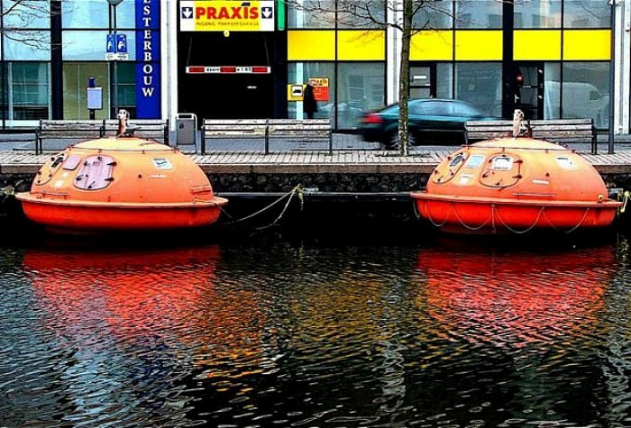 Orange oil rig escape pods as hotel rooms